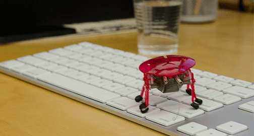 Justinmind office robot on a keyboard