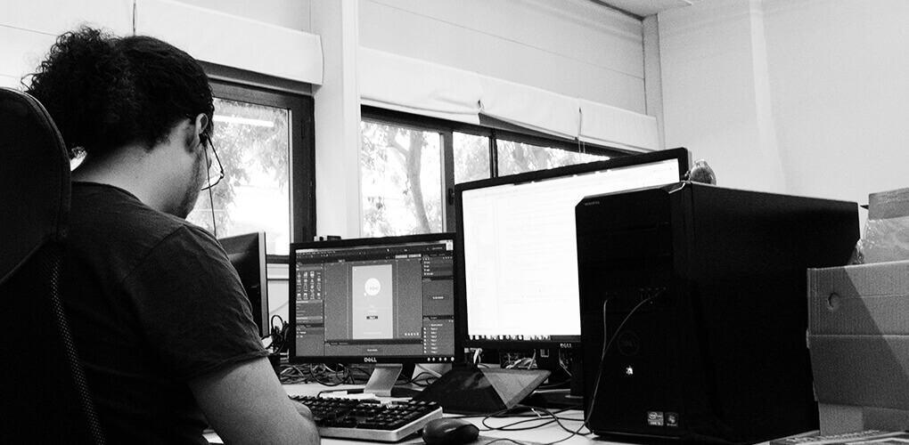 Justinmind team members working in the office